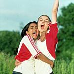 Jesminder and Jules celebrate soccer