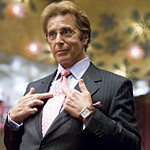 Pacino sports a too-tanned skin tone topped off with virtually matching hair
