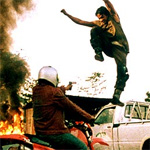 Tony Jaa busts a move on an armed bad guy