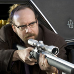 Even Giamatti gets a gun