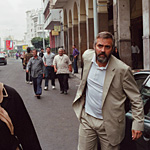 Clooney wears the hunted quality of his character