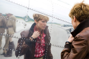 Swank plays Earhart... or at least dresses up as the famed aviator