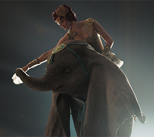Colette (Eva Green) prepares Dumbo for flight
