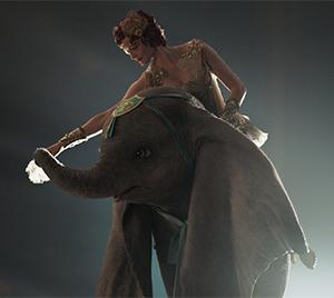 Colette (Eva Green) prepares Dumbo for flight