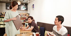A Japanese visitor comes to the Hill of Freedom coffee shop in Korea