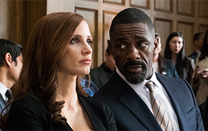 Molly Bloom (Jessica Chastain) and Charlie Jaffey (Idris Elba)