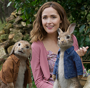 Peter Rabbit (in the blue jacket) with Rose Byrne (the human)