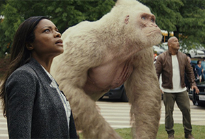 Kate (Naomie Harris), George (CGI) and Davis (Dwayne Johnson) are awestruck