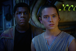 Finn (left) and Rey learn about the Force