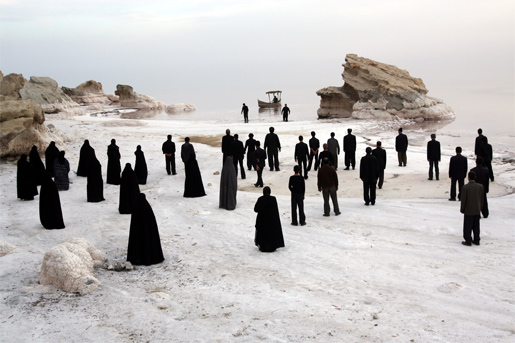 Black-robed figures are the only signs of life