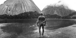 Shaman shows white visitors the Embrace of the Serpent