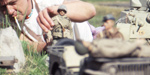 Hogancamp stages a scene from Marwencol